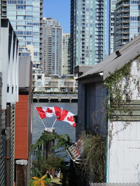 House boats on Granville Island and view of downtown Vancouver.