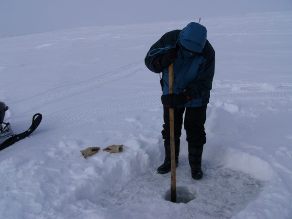 Ice fishing for food.